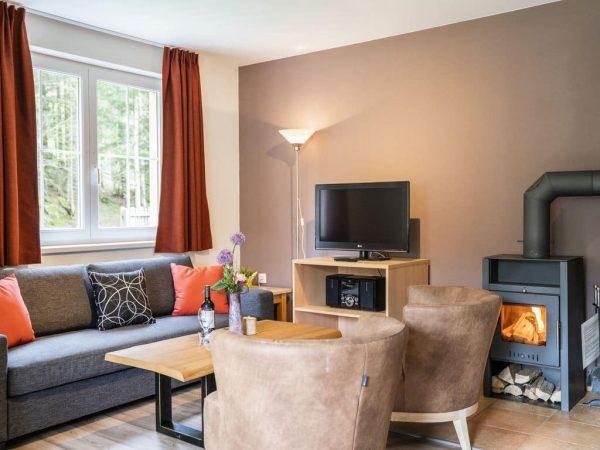 Landal Appartement 6A - Bad Kleinkirchheim - Karinthië - 6 personen - zithoek met houtkachel